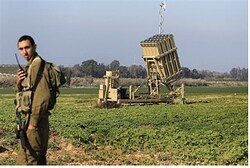 IDF soldier stands near part of Iron Dome system