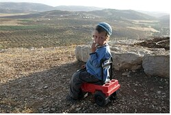A child overlooks the community of Shvut Rachel from Achiyah