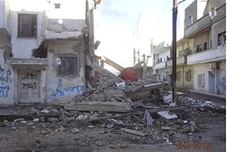 Aftermath of Syria shelling in Homs