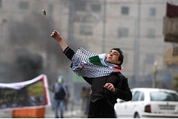 Arab Rioter Hurls Stones