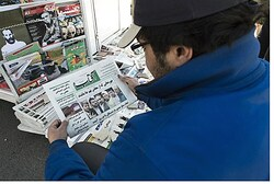 Checking the Sunday headlines in Tehran