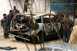 Remains of car in bomb attack in India