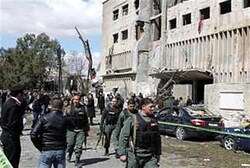 Syrian officials at blast site in Damascus