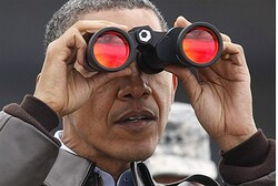 Obama  looks along the border between North and South Korea
