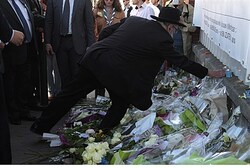 Lighting a candle in memory of Toulouse terror victims