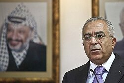 Fayyad with picture of Arafat