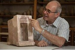Prof. Yosef Garfinkel with a stone shrine model