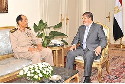 Egyptian President Mohamed Mursi (R), Field Marshal Hussein Tantawi meet  in Cairo, July, 1, 2012
