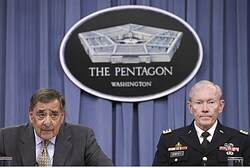 U.S. Secretary of Defense Leon Panetta (L) speaks next to Joint Chiefs of Staff Gen. Martin Dempsey