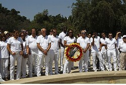 Members of the Israeli Olympic delegation stand during a memorial at a monument commemorating the 11