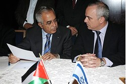 Finance Minister Yuval Steinitz meets PA Prime Minister Salam Fayad as they sign an Economic agreeme