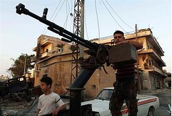 Free Syrian Army member stands by anti-aircraft machine on the outskirts of Aleppo