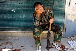 Free Syrian Army fighter  after his friend was shot by Syrian soldiers in Aleppo