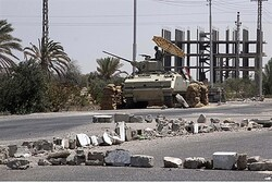 An Egyptian soldier stands guard at a checkpoint in Rafiah