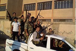 Free Syrian Army fighters pose with their weapons