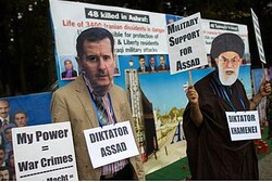 Protesters wear masks ofKhamenei (R) and Assad a