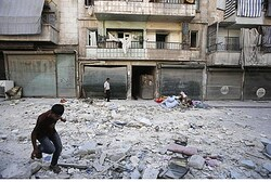 Civilians outside their Aleppo home
