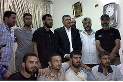 Former Syrian Prime Minister Riyad Hijab and rebels