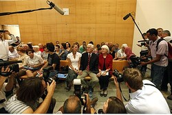 The parents and sister of Rachel Corrie sit together in Haifa district court