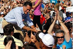 Mitt Romney greets the audience at a campaign rally in Jacksonville, Florida