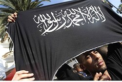 Protester holds Islamist flag at US Consulate in Casablanca