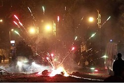 Fireworks explode as protesters clash with riot police along a road at Kornish El Nile which leads t