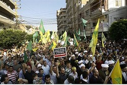 Hizbullah supporters take part in demonstration in Tyre