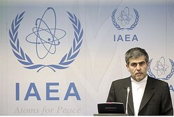 Iran's Head of Atomic Energy Organization Fereydoon Abbasi-Davani reacts as he attends a news confer