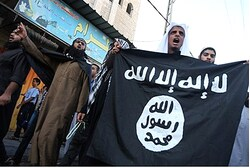Gaza Salafists wave Al-Qaeda flag during protest