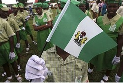 School children wait for the start of Nigeria's 52nd independence anniversary parade in the commerci