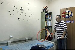 Israeli father views damage to son's room from terror rocket, Netivot