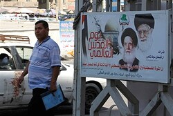 A man passes near a picture of Iranian spiritual leader Ayatollah Ali Khamenei in Baghdad