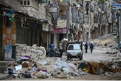 Civilians carry their belongings following fighting in Aleppo