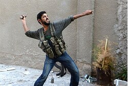 A rebel fighter throws a handmade hand grenade towards pro-Syrian government troops