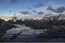 The wreckage of homes devastated by fire and the effects of Hurricane Sandy
