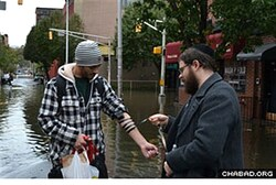 Rabbi Moshe Schapiro helps with tefillin prayer boxes in Hoboken, NJ