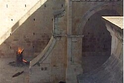 Ancient beams being burned on the Temple Mount