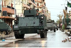 Lebanese Army soldiers patrol the Sunni Muslim Bab al-Tebbaneh neighbourhood in Tripoli