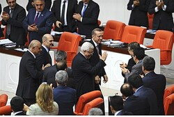 Abbas, accompanied by Turkey's PM Erdogan, greets Turkish lawmakers after speech