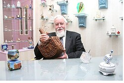 Rabbi Eliyahu Safran and his dreidel collection