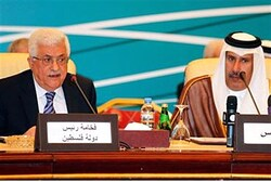 Abbas speaks next to Qatari Prime Minister and Foreign Minister