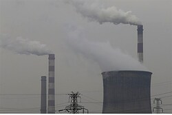 Smoking chimneys and cooling tower of a coal-burning power plant