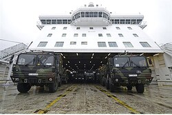 Military vehicles of a Patriot missile system are loaded on a ship in the harbour of Travemuende