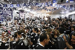 Supporters of Yesh Atid celebrate at the party's headquarters in Tel Aviv