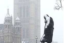 The statue of wartime British prime minister Winston Churchill is seen covered in snow, in front of