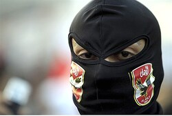 A member of the Black Bloc is seen during the protest in Tahrir Square