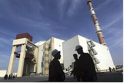 Iranian workers standing in front of the Bushehr nuclear power plant,