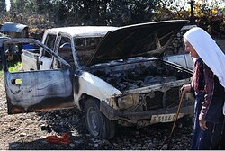 Car damaged by arson (illustrative)