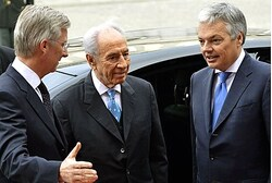 Crown Prince Philippe of Belgium welcomes President Shimon Peres in Brussels