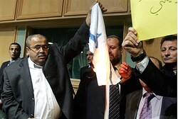 Jordanian MP Khalil Atiyeh burns Israeli flag inside parliament